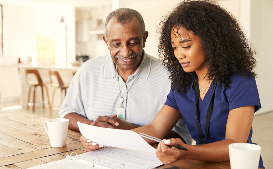 woman and senior man reading a document