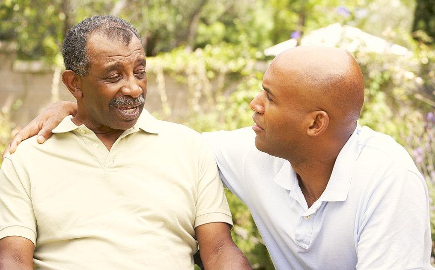 man comforting a senior man