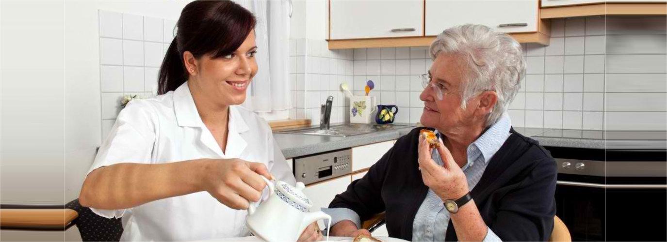woman preparing food for senior woman